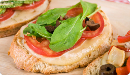 Garlicky Tomatoes With Ricotta and Arugula on Multigrain Toast Serves: 4 Prep Time: 10 minutes Cook Time: 5 minutes Nutrition  per serving: (2 toast halves): 150 calories, 29% fat (5 g; 1g saturated), 20% protein (8 g), 51% carbs (20 g), 3 g fiber, 172 mg calcium, 1.5 mg iron, 233 mg sodium Ingredients 1 T olive oil 1 T minced garlic Salt and ground black pepper to taste 4 plum tomatoes, quartered lengthwise 1/2 cup nonfat ricotta cheese 1/2 t grated lemon peel 4 sli multigrain bread, toasted until crisp 3/4 cup fresh arugula, coarsely chopped Directions Preheat the broiler. Whisk olive oil, minced garlic, salt and pepper in a medium bowl. Add tomatoes and toss to coat. Place tomatoes, cut side up, on a baking sheet and broil until tender and beginning to brown, about 5 minutes. Meanwhile, stir ricotta, lemon zest, salt and pepper in same bowl. Spoon this mixture over toast, then top with arugula. Cut the toasts in half and arrange roasted tomatoes on top.