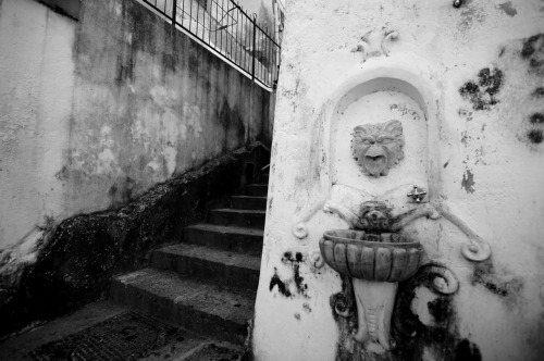 Gargoyle fountain. Amalfi backstreets.