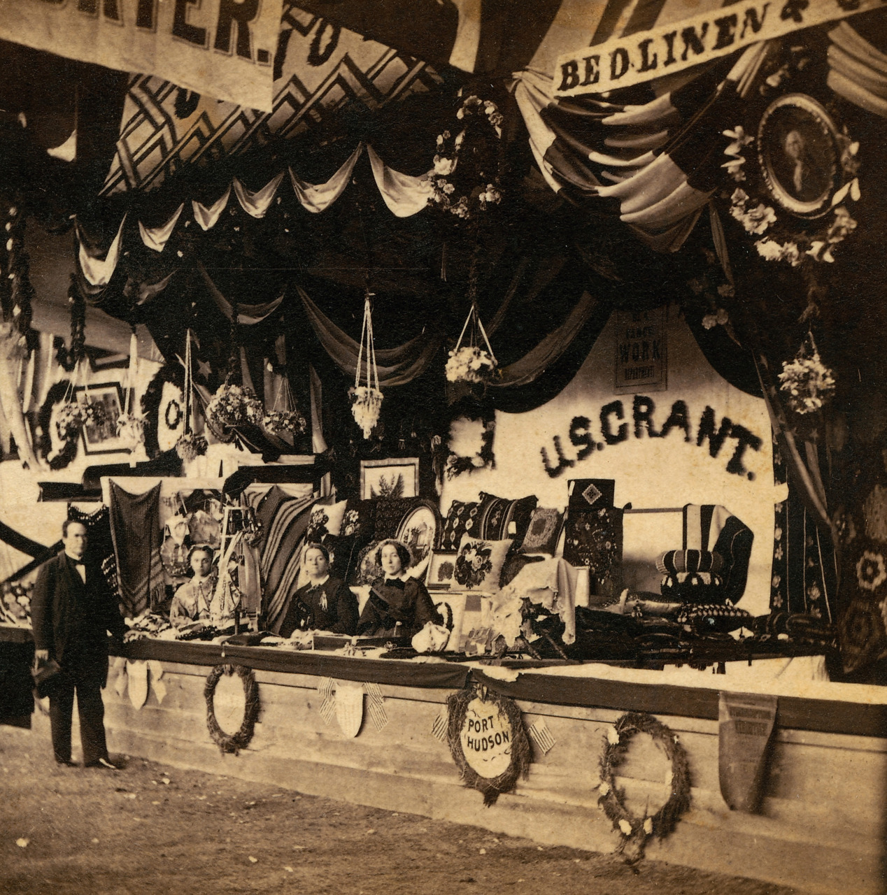 A scene at the Grand Mississippi Valley Sanitary Fair, held from May 17 to June 18, 1864, in St. Louis to raise money for assisting Union troops, their families and freed slaves. A temporary building was erected for the fair in the middle of 12th Street (now Tucker Boulevard) on the two blocks north of Olive Street. It had 54 booths that sold food, clothing, needlework and Missouri-made wine and beer. Many members of the Ladies' Union Aid Society members wanted to ban beer, but relented in a nod to the many pro-Union and pro-beer German immigrants in St. Louis. This booth was named for Gen. Ulysses S. Grant, who had lived for a time in St. Louis and was, at the time of the Sanitary Fair, leading a series of bloody battles in Virginia against the Confederate army of Gen. Robert E. Lee. (Missouri History Museum) See more photos from the fair »