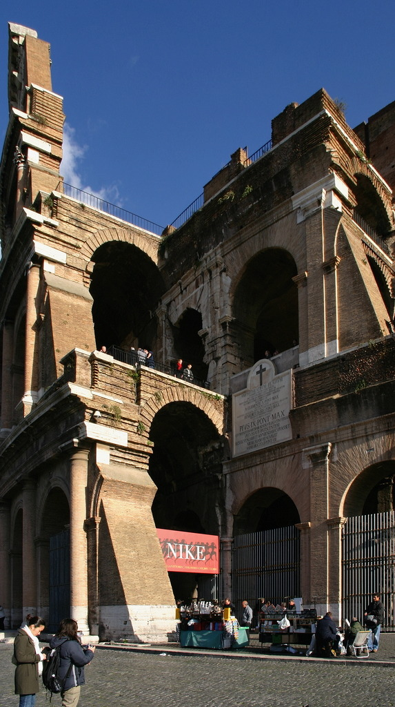 When in Rome… don't buy your entrance card at the Colosseum's entry. There is another selling point at Palatine Hill's entry (Via di San Gregorio) where you can buy any ticket you want without standing in the line. At least this was possible some years ago, and so it should be today.