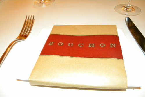 "Bouchon: Yountville  By Jennifer Cotto, Egidia Rubangura and Eric Silvas   Bouchon Bistro is a french restaurant located in the Napa Valley. With locations in Beverly Hills, Las Vegas, and New York, Bouchon is a blend of high-end French home cooking with a casual atmosphere where customers feel relaxed and can take their time to enjoy a meal—and unwind with good company. That is just what our group experienced when dining at Bouchon.    Owner Thomas Keller says on the Bouchon website that ""Bouchon can be, and should be, whatever you need it to be. It's a casual place, a social place, a place where people come to relax, talk and to eat. A kind of home."" Thomas Keller has created a welcoming environment where the staff gives individualized attention to each customer, and makes them feel at home.  While many of the customers are in business attire, our group was casually dressed—some may even say under-dressed. The staff at the restaurant however made is feel quite comfortable and seated us despite not having a dinner reservation. Our server was very helpful, answering all of our questions and suggesting options. Egidia, who's native language is French, even believed that the waiter spoke French as well. His flawless pronunciation of the menu items, and knowledge of French cuisine gave him credibility, and made us take into consideration all of his suggestions. We later found out that he does not speak French, though he is an expert in French cuisine.  There are several features of the restaurant itself that are persuasive. The décor of the restaurant creates the feeling of being in a Parisian restaurant. The thick gold frame mirrors, white crown molding and contrast of the colors paired with the rich red fabric on the soft booth along the wall, make the restaurant look elegant and feel cozy at the same time.  The food was also very persuasive. Bouchon is not an American restaurant serving French food; it is in all respects an authentic French restaurant. The items on the menu feature classic French dishes such as Croque Madame to traditional pates and oysters. They also had dishes that were a French take on other classic dishes such as Gnochi in butter sauce. The menu at Bouchon is a perfect balance between classic, French comfort food and high-end gourmet items. The presentation of the food is as impressive as the food itself. Bouchon is a high end elegant restaurant that is affordable. Its menu offers costumes the ability to experience an elegant restaurant at an affordable price.  Overall, Bouchon Bistro is a highly persuasive business. It is not surprising that at any time of day there are people waiting to be seated. Although it is an elegant high-end eatery, it is also a cozy affordable dining experience where one instantly feels relaxed and welcomed. Other features like the original menus, beautiful location and friendly staff can make it easy for this bistro to become anyone's favorite. Bouchon delivers exactly what it promises on its website: it can be whatever the customer wants it to be, and the staff will meet the customers needs, whatever they may be."