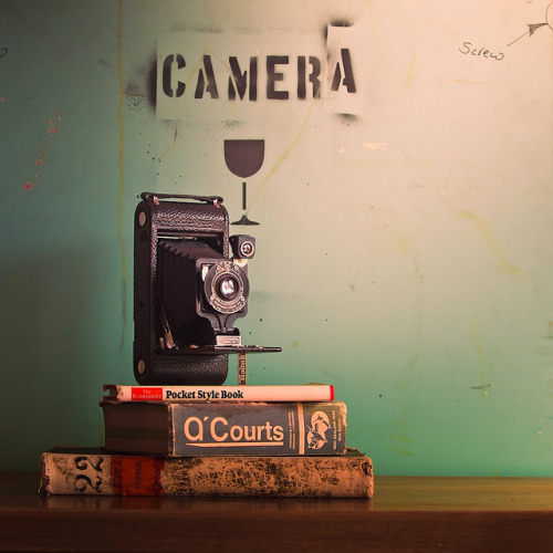 Click Here To See the Before & After Shots.  Vintage Camera & Books on Flickr.