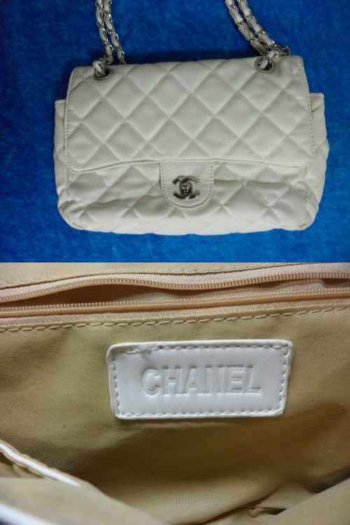 CHANEL REPLICA WHITE PURSE/CLUTCH HANDBAGDouble flap, 4 inner compartments & zip pocketColour: WhiteCondition: Very good, slight cuts on chain unnoticeableSelling for: $30 SOLD