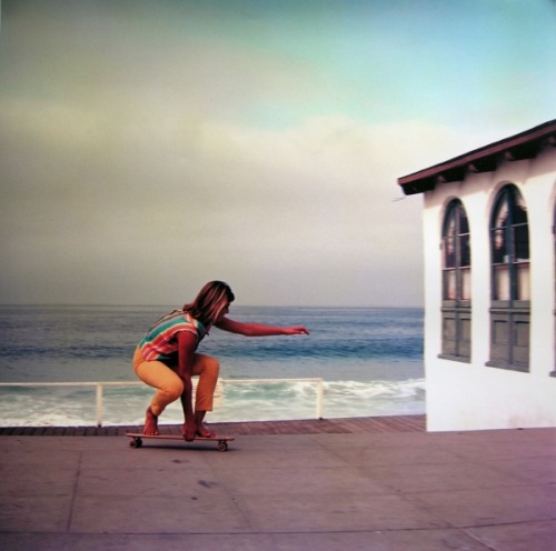"barefoot skateboarder, california, 1971.  leroy grannis. the outfit in this picture instantly makes me think of the beach boys' good vibrations - ""i love the colorful clothes she wears, and the way the sunlight plays upon her hair""… (although i'm pretty sure that's a dude.)"