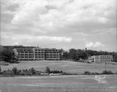 1936 photograph of Lakeview Sanatorium and nurses' dormitory in Madison, WI.  That hill is steeper than it looks, and the road is now closer to the tree line in the front of the photo. I believe that the nurse's dorm is gone, and the side of the hill is covered in pines, with massive willows at the bottom.  I have fond memories of that area. The woods are beautiful, and there's a very old cemetery along a path behind the larger of the buildings. Part of the old sanatorium is used as offices, but I believe the other part is not used at all. I wish I were able to explore it. The hill is great for sledding, and every year, there are hundreds of people that gather on the last weekend of June for the Rhythm & Booms fireworks show. The main staging place is at Warner Park just down the street, but the people in the neighborhood tend to gather on the hill. The old sanatoriums I've seen always seem to transform into places of life, rather than a place where people go to die.