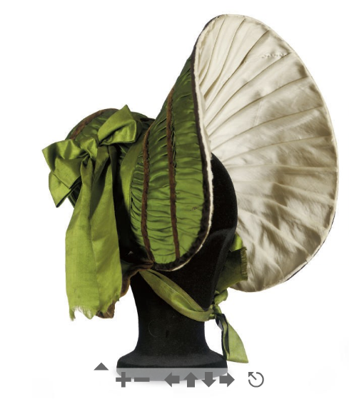 ornamentedbeing:  A GREEN SILK BONNET 1830S of extravagent shape, wide brimmed and lined in pleated cream silk, trimmed with chocolate velvet ribbons and later wide green silk ribbons19in. (48.25cm.) diameter  Well I was actually going to buy this one from Christies but I was sniped at the last minute by someone who came in and bid £2,000 ($3,568) against my measly £20. Justttt Joking.