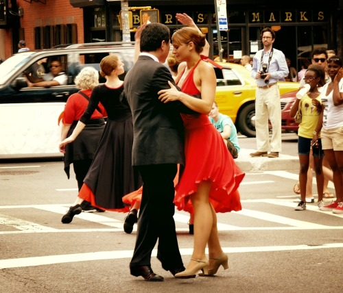 New York Dance Parade. An intimate moment. East Village, New York City.  Reason #467896 that I love New York City: I went out to get a late breakfast at Odessa and after enjoying some mighty fine pancakes I stumbled onto the beginning of the 2011 New York Dance Parade on St. Mark's Place. There were so many great moments but this is one of my favorites.   In a city of around 8 million people, sometimes everything and everyone else melts away.    View more photos at my The New York Dance Parade 2011 photo set.   —-  You can now also purchase my photography on a wide variety of merchandise (t-shirts, magnets, postcards, iPhone/iPad cases, posters, the list goes on). To view all of these  New York City gifts and products at my store, click here.