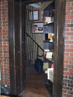 Secret bookshelf door conceals hidden staircase