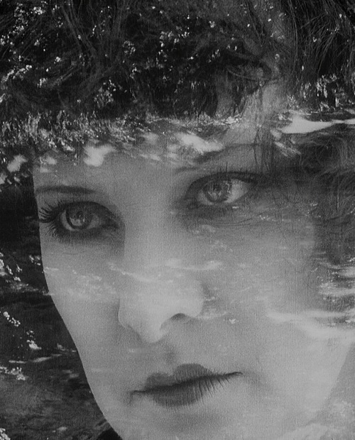 Gina Manès in Faithful Heart (Coeur Fidèle) (1923, dir. Jean Epstein) Epstein experimented with superimposition to depict the inner despair of his characters, as in this shot in which the protagonist's face is laid over an ugly waterfront.