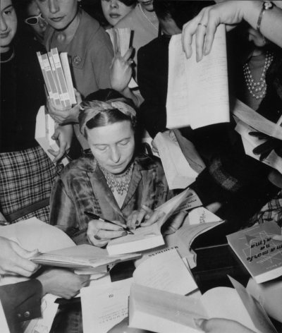 coolchicksfromhistory:  via beauvoiriana: Simone de Beauvoir signing books. This photo is the cover of the French edition of the second volume of Force of Circumstance (1972). Curious detail: on the right, someone asks her to autograph Troubled Sleep (in Portuguese) by her long term romantic partner Jean-Paul Sartre.