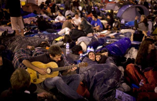 "pantslessprogressive:  Demonstrators spend the night at Puerta del Sol Square during a protest in Madrid, early Sunday, May 22, 2011. Thousands of Spaniards defied a ban on a pre-election demonstration and have mounted a protest camp in the heart of the Spanish capital to express anger at political parties and the country's handling of the economic crisis. The crowd have packed the square since last Sunday and pledged to stay there until municipal and regional elections this weekend. [Photo: Emilio Morenatti / AP] Weekend News Roundup: Algeria, Bahrain, Egypt, Georgia, Morocco, Spain, Syria, Tunisia, Yemen Algeria: Algeria to hold reform talks, boycotted by opposition | AFP Bahrain: Bahrain upholds death sentences for Shiite protesters | AFP Bahrain's top human rights activist targeted two days after Obama speech | McClatchy Al-Wifaq has reportedly decided to return to its boycotting roots and will not contest in the make-up elections scheduled for September 2011 | Bahraini Politics After destruction of the actual protesting site at ""the Pearl"", the government shifts to eliminate virtual protests 