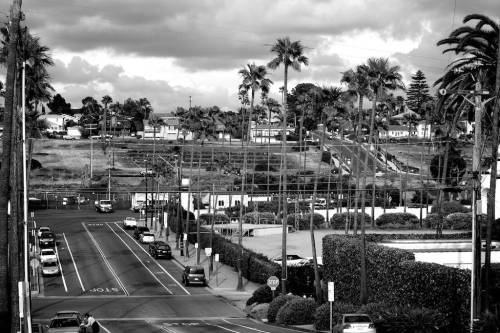 more interesting in black and white … Encinitas really isn't a very picturesque town — especially when contrasted with Totnes in the UK …  which I do fairly frequently these days …But, this shows you a section of 101 , with Santa Fe drive heading up the hill. I live about 2 miles up  hill from here — with, lucky me, ocean view and ocean breeze …