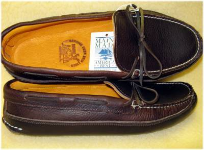 Moccasins from New England: Arrow Moccasin and Town View Leather I love the idea of canoe slippers, the Northeastern staple. They're soft, tough leather shoes, suitable for wear indoors or out. Quoddy has gotten a lot of attention in the menswear world the past few years (I presume they have a good publicist), and they make a fine product. There are other options, though. I have a pair of trail boots by Arrow Moccasins, and recommend them highly. They're comfortable with or without socks, and are my go-to for autumn lounging. They're also hand-made by a father and son team, who answer the phone with charming New England accents. I wore them on concrete for a year or so with no ill effect, but then I got rear-ended in a car accident and found that long walks in such unpadded shoes made my back act up. The Arrow last is broad and masculine, and I wanted slippers that were a little more refined in shape, so I placed an order with Town View Leather of Maine. They're also a family operation, and their finest deerskin lined mocs still come in at less than a hundred bucks. I've got a foot tough to fit for slip-ons, and I had to return them, but doing so was painful. These are beautiful shoes. You can even buy their basic, unlined model for less than $60 on eBay. If you have special width requirements, they can accommodate at no extra charge, and I received my shoes (in a special width) within a week of placing my order. If you're looking for soft, comfortable shoes, look no further than these two classy outfits. Hand-made products made by expert craftspeople at reasonable prices: you can't beat that.