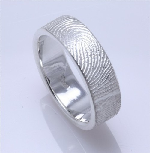 fingerprint wedding ring. the couple molds their fingerprints on to each other's rings so they never lack the other's touch. (I would like to see them make these in different metals and with the imprints on the inside of the ring.) UPDATE: They do. I have my wedding band, but I want to order the thin one just because. (found here.)