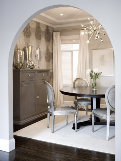 A silver and grey themed dining room with a fun detail - a Sputnik