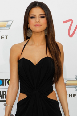 2011 BILLBOARD AWARDS - SELENA GOMEZ IS SLEEK IN BLACK & NOT AFRAID TO SHOW SOME SKIN To  know what's hot and what's not in the rocking world of music; there's  no better indication of the ultimate chart toppers than those announced  winners at the Billboard Awards. Source: Just Jared FYI: The hottest fashion styles like Selena's look can be found here: http://amourlamode.tumblr.com/