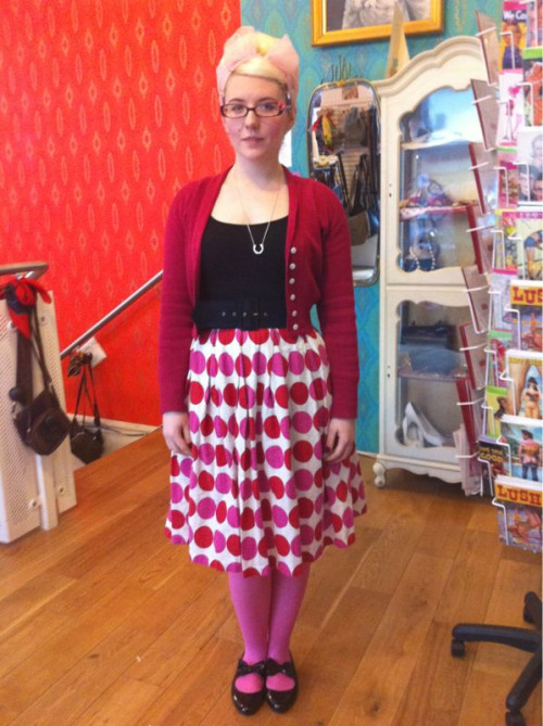 It's been a while!  Wearing: pink primark tights, vintage skirt, h&m tee, vintage belt, pop cardi, office flats and Fred perry necklace.  Hair: beehive with pink scarf  Feeling: very pink! I have tomorrow off so this eve I am going to sew sew sew and tomorrow I am seeing my friend Sasha, any ideas on tomorrows outfit theme?