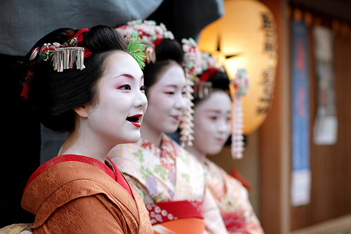 Maiko Geisha (apprentice) outside a tea house, Kyoto, Japan (by momoyama)