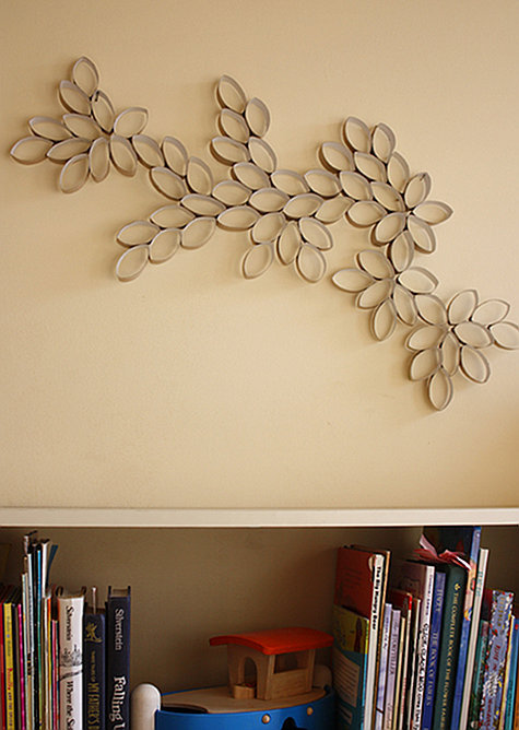 "This cute ""wall art"" (by Design Sponge Online) is made from something we all have in our homes, toilet paper rolls!! I can't wait to try this one out. Materials: Toilet Paper rollsScissorsWhite glueStaplerPaint + brushesGlitterLaundry pins Steps: 1. Crush paper roll 2. Cut into approximately 5 equal parts don't have to be exact 3. Place the rolls on a flat surface creating a desired pattern. spend time trying different compositions and patterns. 4. Glue where rolls are touching, hold with laundry pins to dry. You may use a stapler as an alternative, what ever is easier. I find that glue is easier for the younger kids. 5. You may paint and add sparkles. Sprinkle the glitter on the wet paint, this way it will sticks and you wont need any glue. 6. You may expend the pattern in to an organic cell growth. The challenge is when to say STOP."