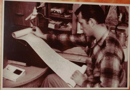 "Jack Kerouac holds the original scroll of ""On The Road"""