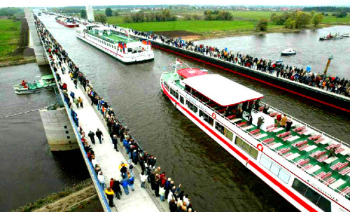 526. Pass by the Magdeburg Water Bridge in GermanyPretty cool and unique bridge, IMO. :)