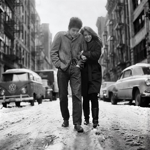 ckck:  Bob Dylan and Suze Rotolo walking along Jones Street, New York City in February, 1963. A few months later this photo would be used as the album cover for The Freewheelin' Bob Dylan (as you surely know). Photograph by Don Hunstein.