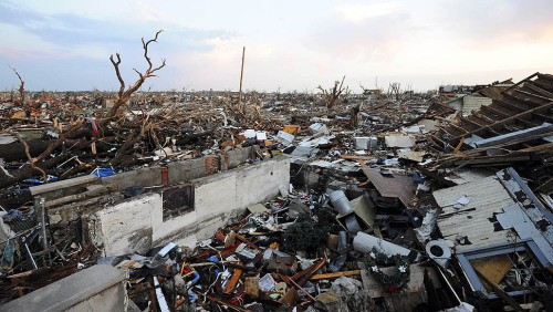 One of a number of homes in Joplin, Mo., lies in ruins after the devastating tornado. View more photos on Framework. Photo credit: Larry W. Smith / EPA