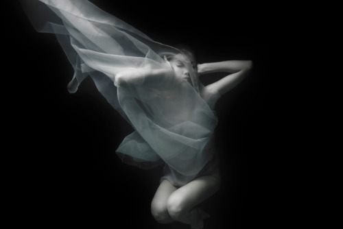 "Tomohide Ikeya photography from the ""BREATH"" series.  ""We only realize the true value of the things in the moment of losing them, ""BREATH"" is my latest work, focuses on breath, a vital activity of human-beings which is controlled by ourselves. An infinite number of air bubbles appeared in the water enables us to see 'breath' with vivid clarity.  Although we breath unconsciously in our ordinary lives, it is not easy to breath under water Losing air that we need for life, being enabled to breath, being controlled by water. We realize true value of things that always exist around us, in the moment of losing them. Some people accepts its control and wait for the end to come without bidding defiance to it, The others are thirst for life, struggling against it and trying to control themselves. That is the contrast of holding on to life, which appears clearly under water. ""BREATH"" asks viewers questions.  What is the things you should know the value of, hold on to and control? And what is the most necessary thing for your life?"" (via)"
