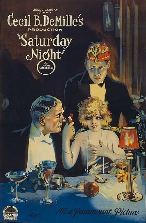 theloudestvoice:  Leatrice Joy, Jack Mower, and Conrad Nagel (with hat) on poster for Saturday Night, 1922