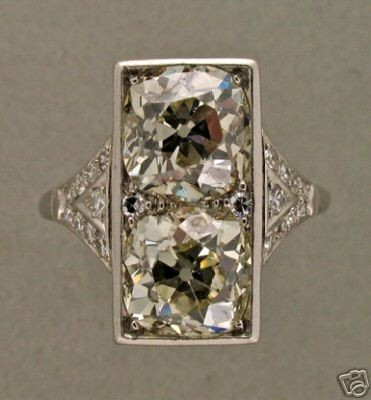 art deco ring. (found here.)