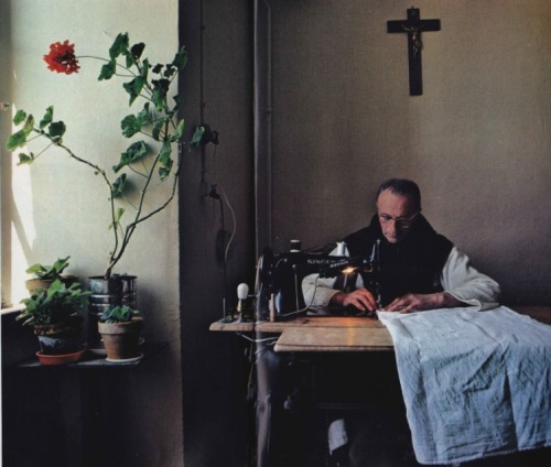 a monk stitching sheets in Our Lady of the Snows, a Trappist monastery in South-Central France. October 1978