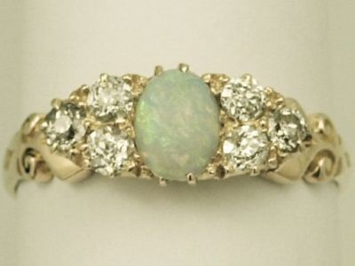 vintage ring. opals and diamonds.  (found here.)