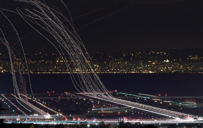 Long exposures of planes taking off by Terence Chang