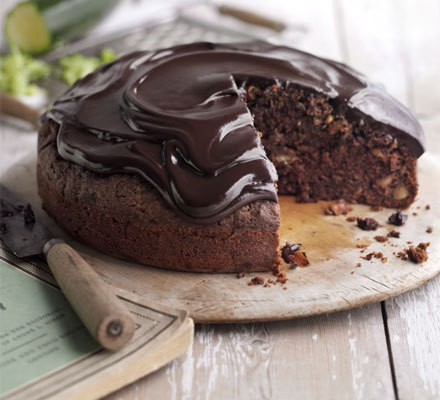 Chocolate Courgette Cake Recipe - 350g (1 1/2 cup) self-raising flour (or rice flour)- 50g (1/4 cup) cocoa powder- 1 tsp mixed spice- 175ml extra virgin olive oil- 375g (1 2/3 cup) golden caster sugar (or sugar substitute)- 3 eggs- 2 tsp vanilla extract- 500ml 		        		 						 		    		                                                                                                                                                                                               grated                                                                                                                                                                  courgettes                                                                                                                                        (measure by volume in a measuring jug, but it's  about 2 medium courgettes; if using 1 overgrown one, peel first and take  out seeds)- 140g (2/3 cup) 		        		 						 		    		                                                                                                                                                                                               toasted                                                                                                                                                                  hazelnuts, roughly chopped For the icing:- 200g (1 cup) dark chocolate, chopped- 100ml (1/2 cup) double cream Heat the oven to 180C/160C fan/350F/gas mark 4. In a large bowl, combine the flour, cocoa powder, mixed spice and 1 tsp salt. In another bowl, combine the olive oil, sugar, eggs, vanilla essence and grated courgette. Mix the dry and wet mixture until just combined, then fold in the toasted hazelnuts. Line a 24cm cake tin with greaseproof paper, then pour in your mixture. Bake for about 40-50 mins, or until a knife inserted into the middle comes out clean. Cool in the tin for 10 mins, then turn out onto a wire rack and leave to cool.  To make the icing, place the chocolate in a bowl and bring cream to the boil in a saucepan. Pour the hot cream over the chocolate and stir until completely smooth and melted. Leave the icing to cool slightly and thicken, then spread it over the cake so it's covered and the icing starts to drip down the sides. Serve with a cup of tea or enjoy as a pud with a spoonful of something creamy.