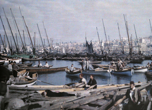 A view of Istanbul's port; caiques in foreground are city's gondolas. Location:Stamboul, Turkey.Photographer:GERVAIS COURTELLEMONT/National Geographic Stock