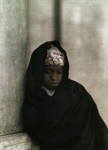 A portrait of a young Nubian girl. Location:Egypt.Photographer:GERVAIS COURTELLEMONT/National Geographic Stock