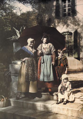Women and children pose in traditional costumes of Provence. Location:Provence Province, France.Photographer:GERVAIS COURTELLEMONT/National Geographic Stock