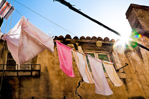 Croatia - Split: Wash Day by John & Tina Reid on Flickr.Residents in the old Palace of Diocletian in Split hang their washing over the streets to dry, painting the old palace in a wash of colour. The Palace of Diocletian. Building of the palace began in 305AD. The palace is now a UNESCO world heritgage location. John & Tina Reid | Travel Portfolio | Photography Blog | Travel Flickr Group