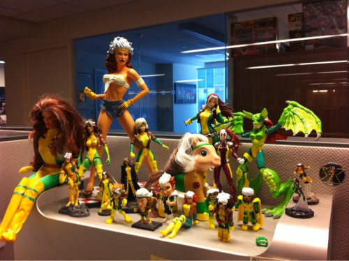 Marvel collections editor Jen Grunwald has a killer collection of Rogue stuff at her desk. Every time I walk by, I see Rogue's butt. via igotkittypryde:  [geek] My awesome collection of Rogues has expanded!! [/geek]