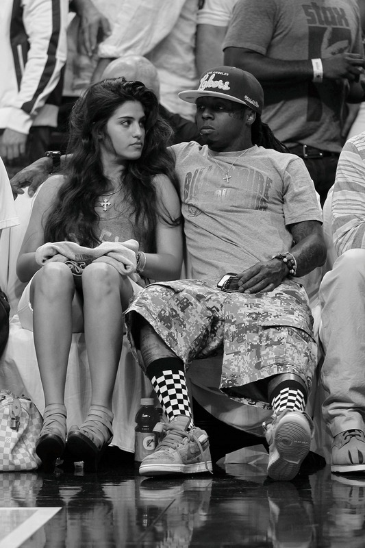 Weezy was seen courtside with his new woman at the Miami Heat vs. Chicago Bulls game