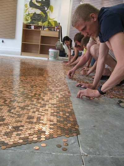 homemadecrap:  DIY Penny Floor via Revolver Yesterday I posted about a penny table, today I came across this penny floor. I applaud anyone who has the patience to do this to a floor!