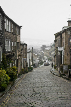 tocamelot:  Main street of Haworth  | by © Dave Gunn | via lottietea This was one of my favorite places in all of Yorkshire. And the Bronte Parsonage was wonderful. We had the whole museum to ourselves :)