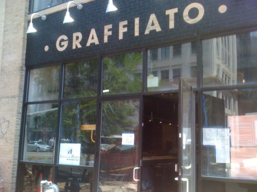 "Top Chef alum Mike Isabella's forthcoming restaurant, Graffiato, seems to be rounding into shape, as seen on today's post-lunch walk back to work.   The restaurant's website says ""Spring 2010"" opening. Based on a quick peek inside, I'd guess it's about 2-3 weeks out.  I am very excited that this will be one of the closest restaurants to the office!"