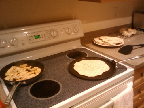 "PLATO's Homemade Tortillas  These are simple and  delicious. Wrap up chicken, beans, meat in them, or slap some butter and  jam on them. Or, tear them up and put them in soup. This recipe's from  my great grandmother. Makes 10 10"" tortillas (or more smaller tortillas.) Combine 3 cups flour, 1 tablespoon baking powder, 1/2 teaspoon salt Add about 1/2 cup milk, mix. Water or soy milk works too. It'll be  too dry at first - keep adding splashes of milk until the dough is too  tough to stir, at which point, start kneading with your hands. You want a  dough that's just past smooth and just into sticky. If it gets really  sticky, add more flour and knead it in. Add more milk if it's too dry. Break the dough into pool-ball sized chunks for 10"" tortillas or  golf-ball sized chunks for 6"" tortillas. Dump a handful of flour on your  work surface - a clean countertop has more room than a large cutting  board. Grab a ball, roll it around in the flour so it's not sticky, and roll  it out with a rolling pin. Keep flipping it over and rotating it to get  it into a circle. Roll them as thin as reasonably possible without  breaking them. Toss the rolled tortilla onto a hot skillet or frying pan. I use 5 on  a 1-10 scale electric range. The surface should start to bubble within  10 seconds, if it doesn't, it's too cold. Wait a total of about 25  seconds and flip the tortilla over with fingers, a fork, or a spatula.  The bottom side should be cooked with a few browned or blacked spots. If  it's burned already, your range is too hot. Cook the other side another 25 seconds or so. Some black's OK but  most of the tortilla should still be off-white. Taste it - it should be  soft, not crunchy. If it's really chewy, they're either rolled too  thick, or not cooked long enough. Toss your stack of finished tortillas in the oven to keep them warm. Enjoy! -PLATO"