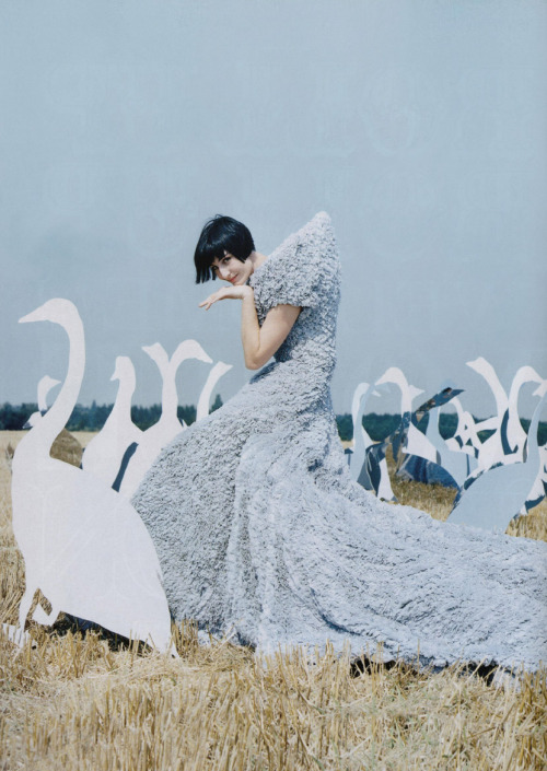 Erin O'Connor wear Alexander McQueen's plumed grey dress by Tim Walker
