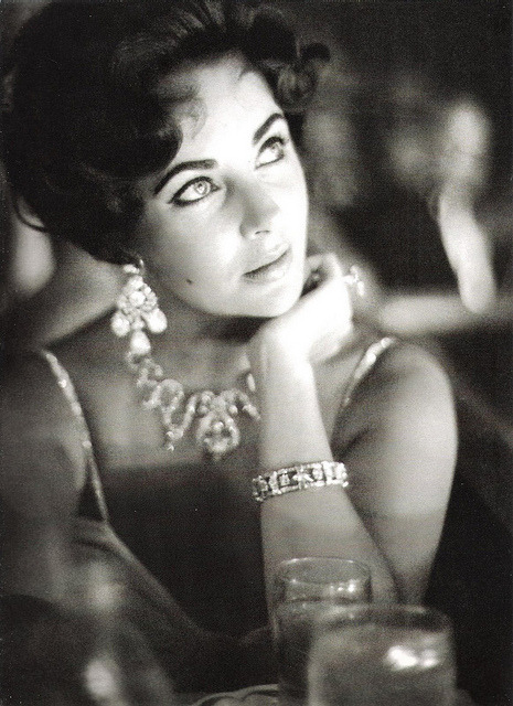 redtoybox: Elizabeth Taylor wearing a creation of Balmain and Cartier jewels, photographed by Richard Avedon, Harper's Bazaar July 1961.