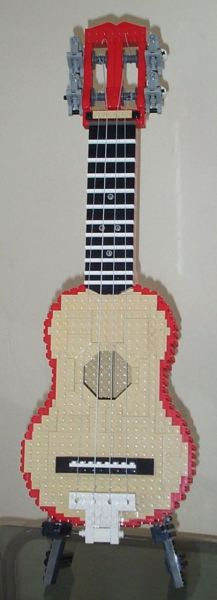 Lego Ukelele of the Day: Ross Crawford's ukelele is a bit different from your standard uke. It's tuned to C-F-A-D instead of G-C-E-A. Oh, and it's made entirely of Lego. [brothersbrick]