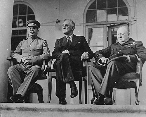 Stalin, FDR, and Churchill pictured at the Tehran Conference. The central aim of the conference was to plan the final strategy for the war against Nazi Germany and its allies, and the chief discussion was centered on the opening of a second front in Western Europe.