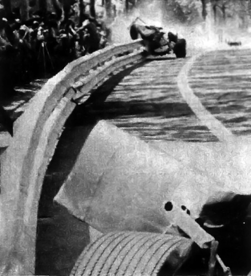 Jochen Rindt's crash at Montjuïc '69 - Part II (Part I, Part III, Part IV, Part V, Part VI) Hill's car in the foreground, also crashed.