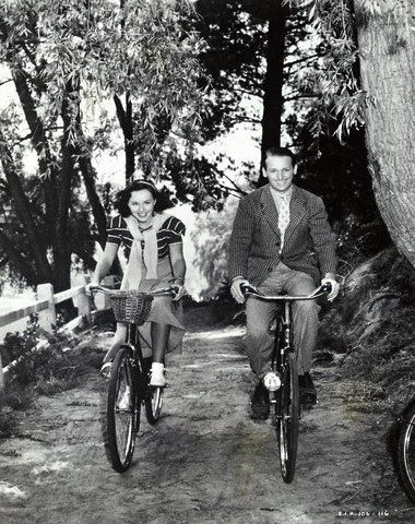 ridesabike:  Paulette Goddard and Douglas Fairbanks Jr. ride bikes.